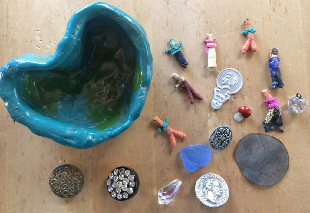 trinkets as treasure, coin button, worry dolls, sparkly button, crystal, seaglass
